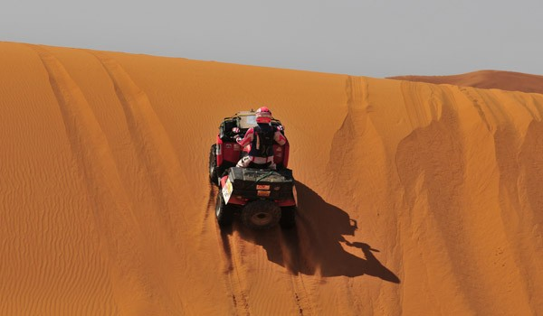 Quad bike on dune